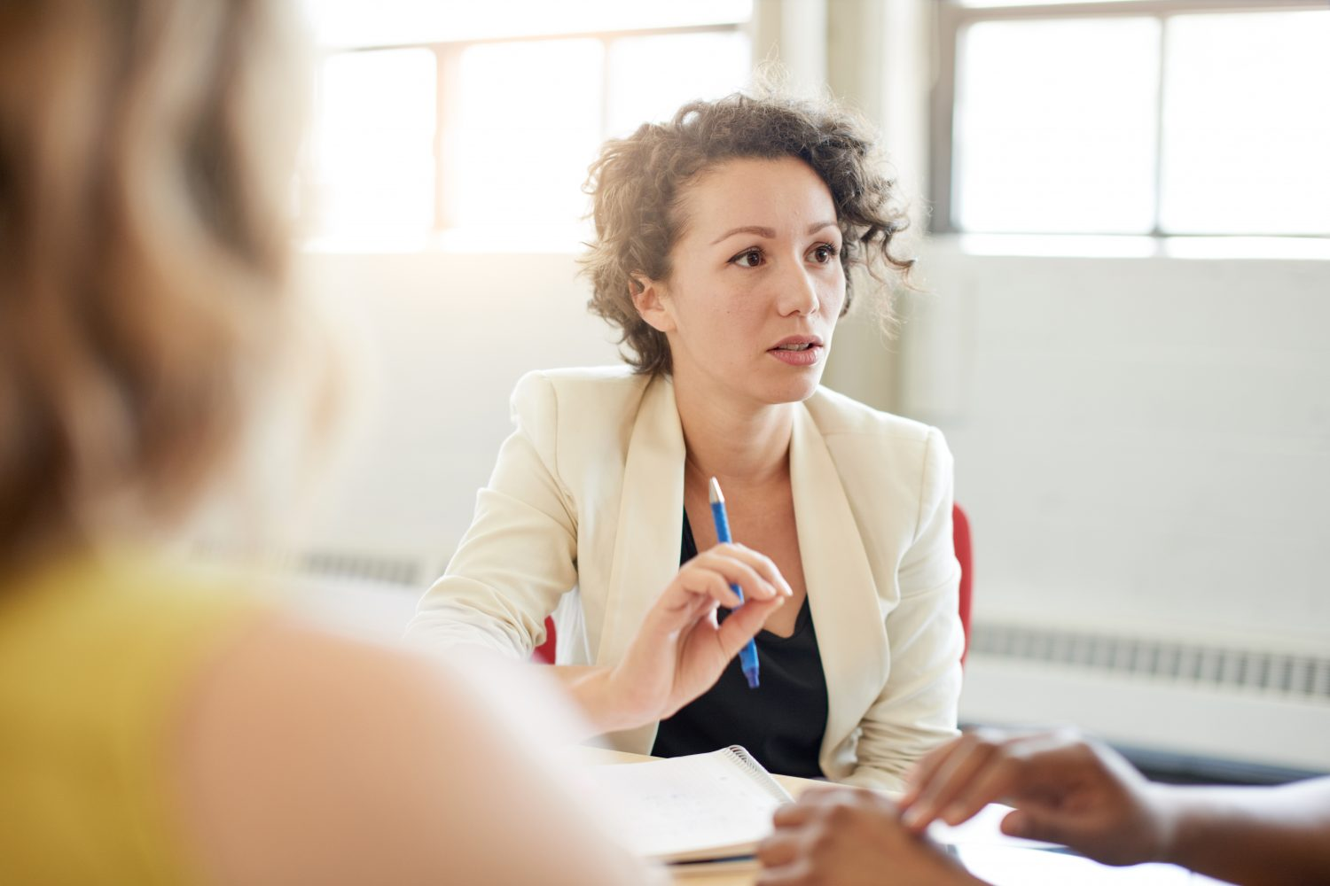 Woman concentrating on conversation with colleagues