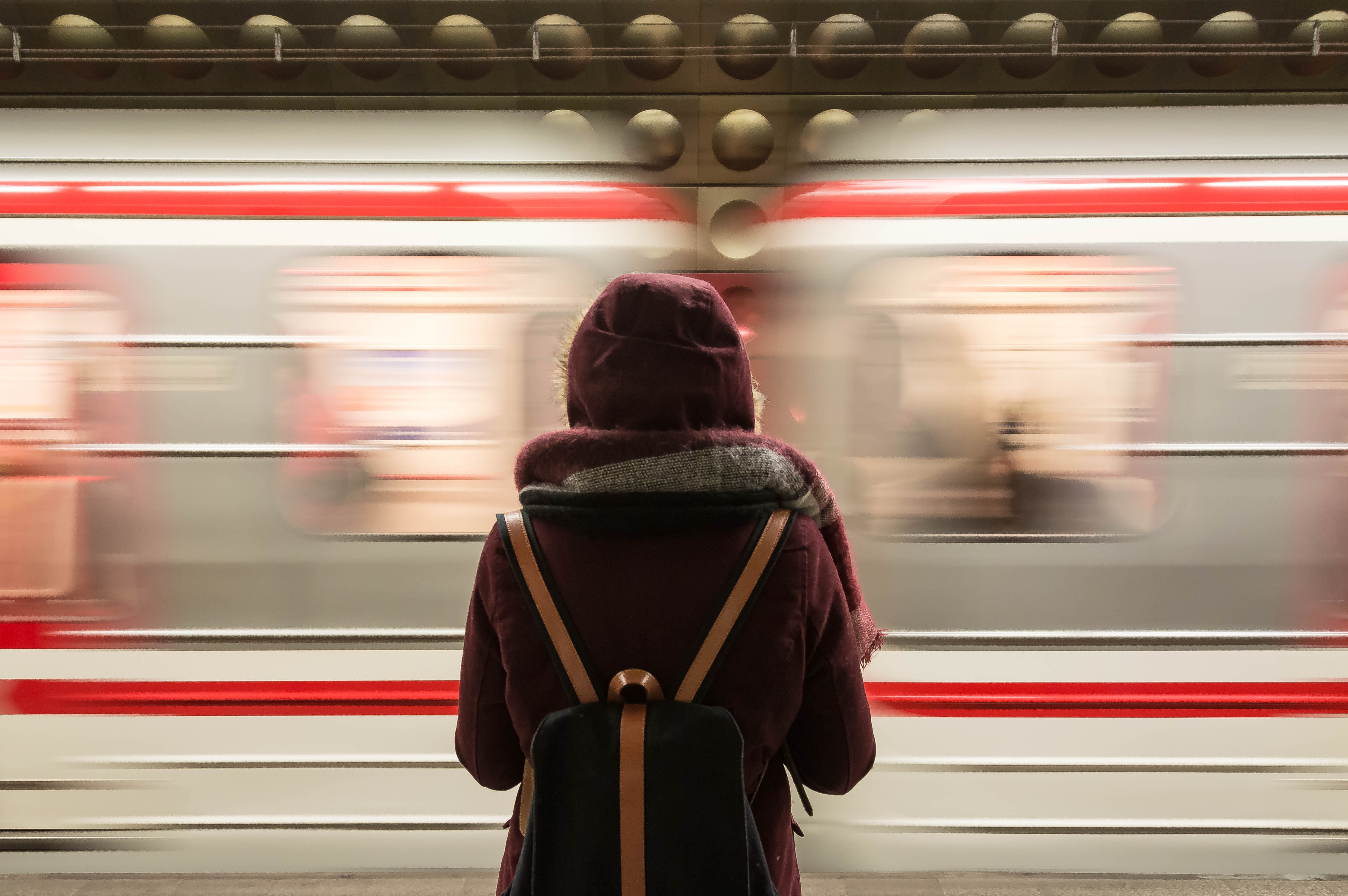 Train passing a passenger by (Photo by Fabrizio Verrecchia on Unsplash)