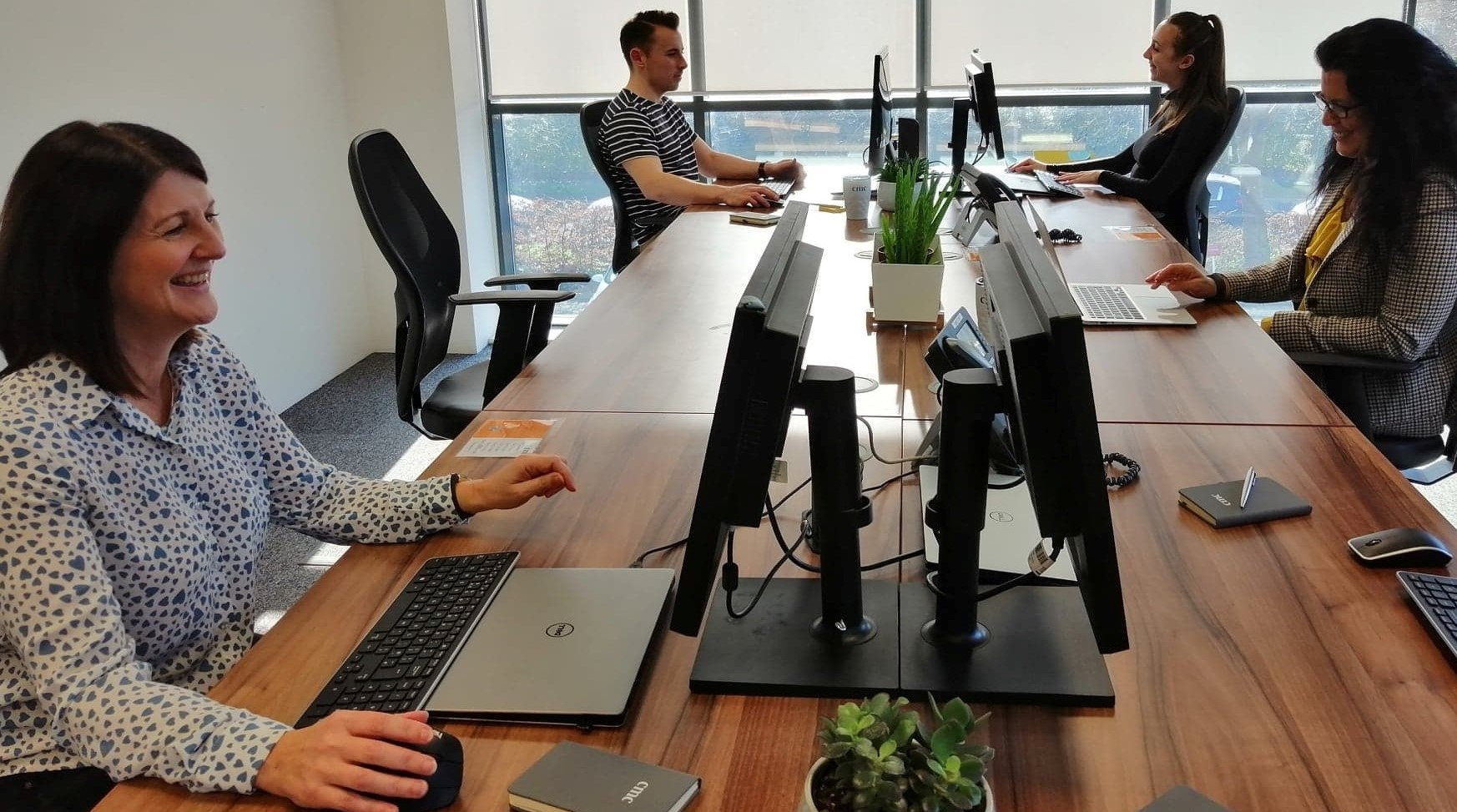 Some of our busy support team enjoying the new office!