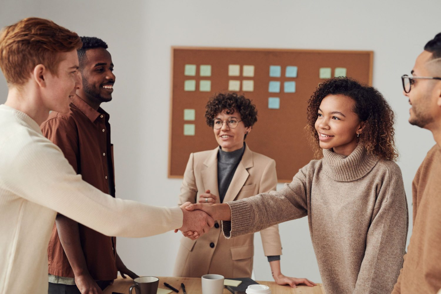 New team members shaking hands. Photo by Fauxels by Pexels