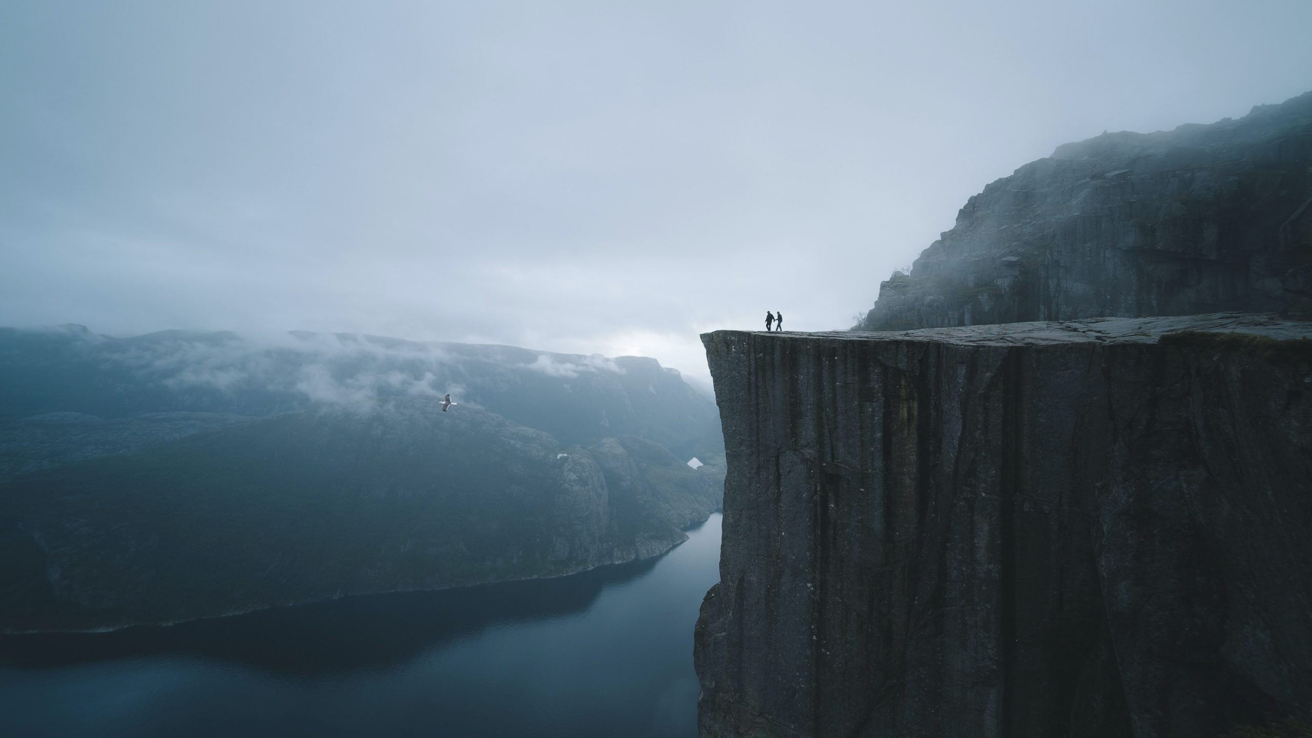 Landscape with cliffs and people on edge. Photo by Valdemaras from Pexels