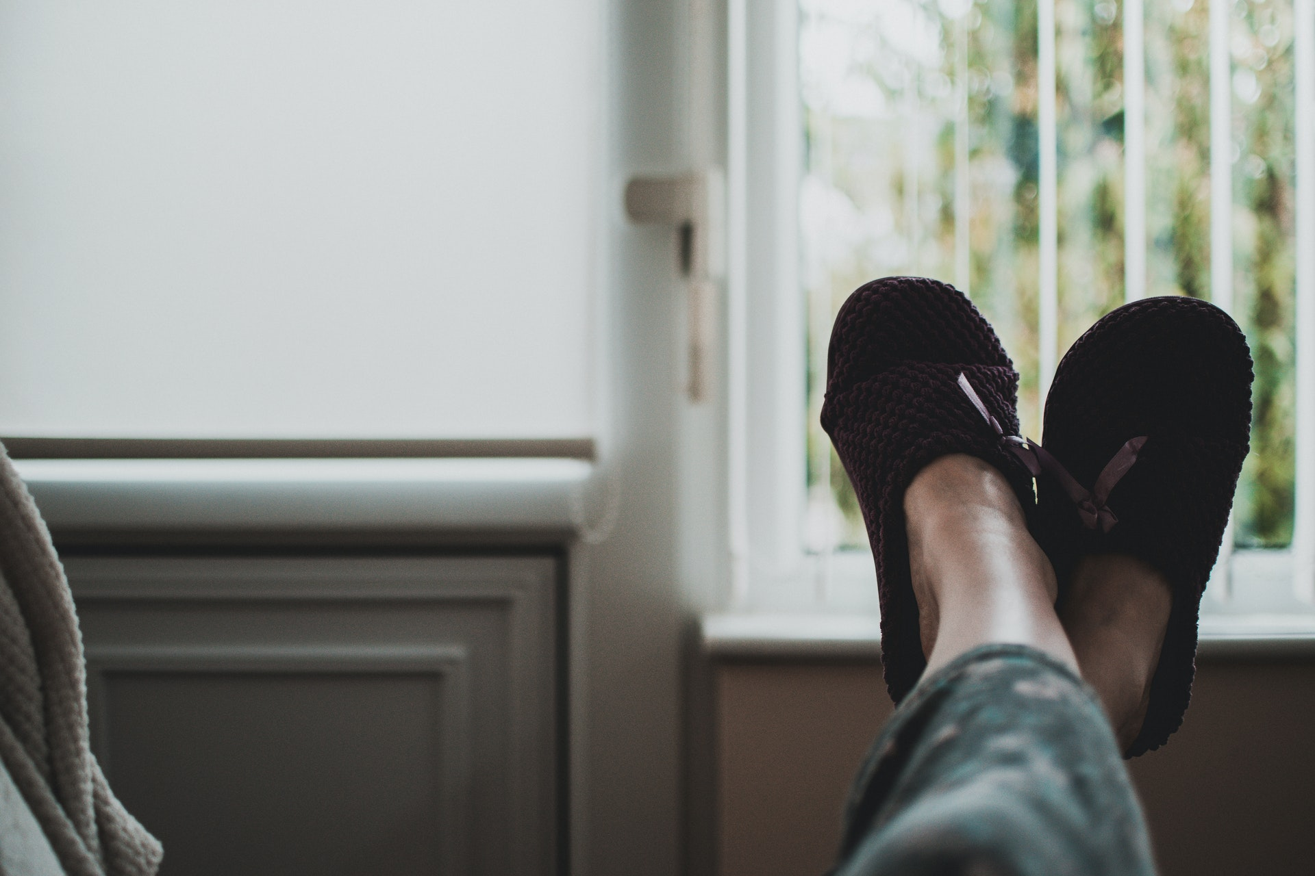 Person with feet up on sofa Photo by Alex Powell from Pexels